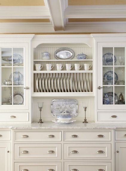 Traditional Kitchen with white cabinets and a plate rack to show off the transferware dishes