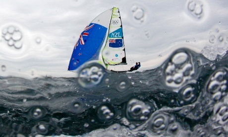 Let's hope Pascal's camera is waterproof. New Zealand's Peter Burling and Blair Tuke sail before the fifth race of the men's 49er sailing class in Weymouth. Photograph: Pascal Lauener/Reuters