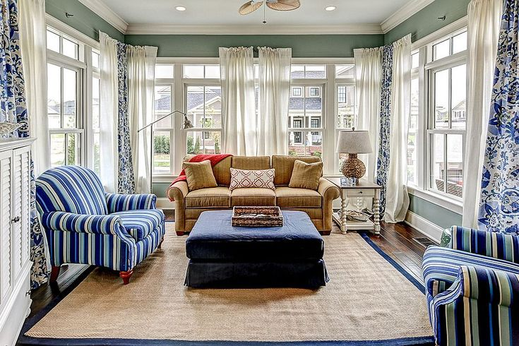 Decor in blue and white is perfect for the beach style sunroom [Design: JH Designs / Tim Furlong Jr. Photography]