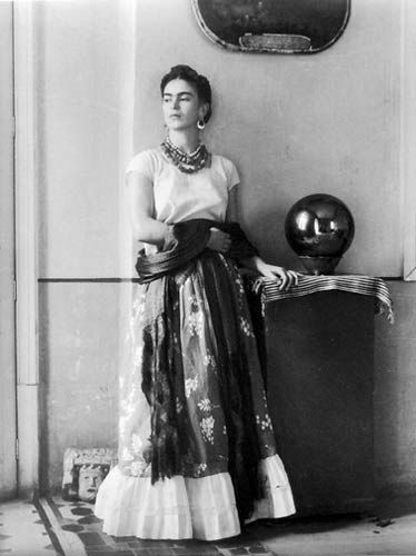 """Frida has been described as: """"…one of history's grand divas…a tequila-slamming, dirty joke-telling smoker, bi-sexual that hobbled about her bohemian barrio in lavish indigenous dress and threw festive dinner parties for the likes of Leon Trotsky, poet Pablo Neruda, Nelson Rockefeller, and her on-again, off-again husband, muralist Diego Rivera."""""""