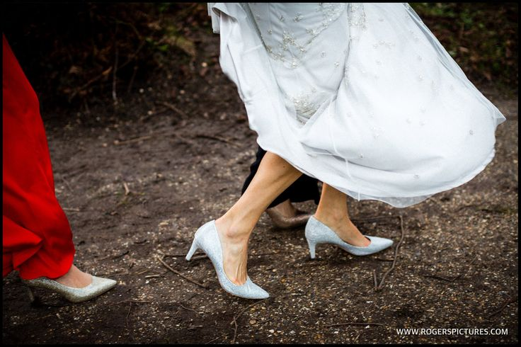 The arrival of the Bride in her Badgly Mischa shoes - http://www.rogerspictures.com/blog/2016/4/winter-marquee-wedding?utm_content=bufferfe26c&utm_medium=social&utm_source=pinterest.com&utm_campaign=buffer