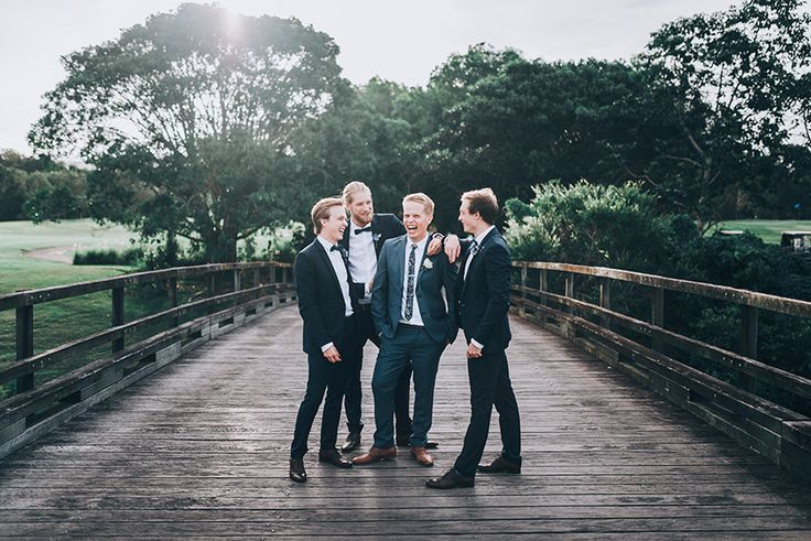 Classic groomsmen fashion, dark suits, black bowties, Groom with floral tie (The Glades, Robina)