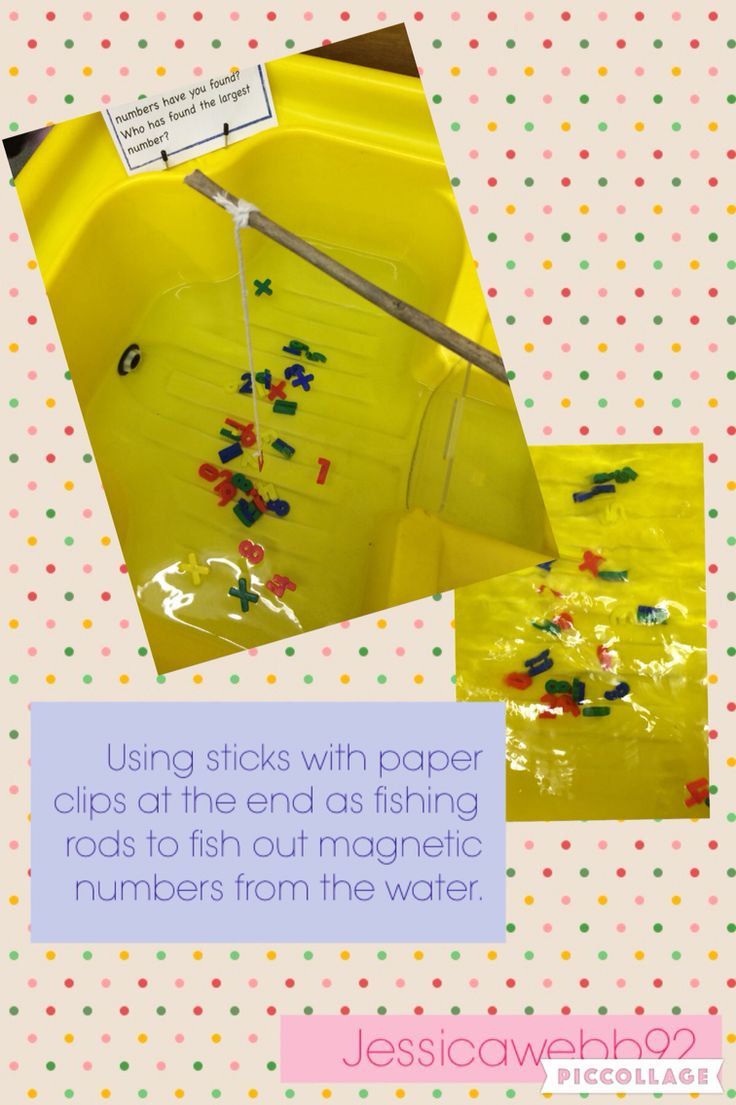 Fishing out magnetic numbers using sticks with paper clips attached with strong. EYFS