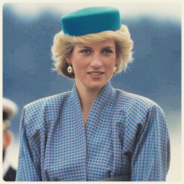 """01 May 1986: Princess Diana, wearing a blue pillbox hat designed by milliner Gina Foster, attend a reception at Swy-A-Lane Park in Nanaimo, British…"""