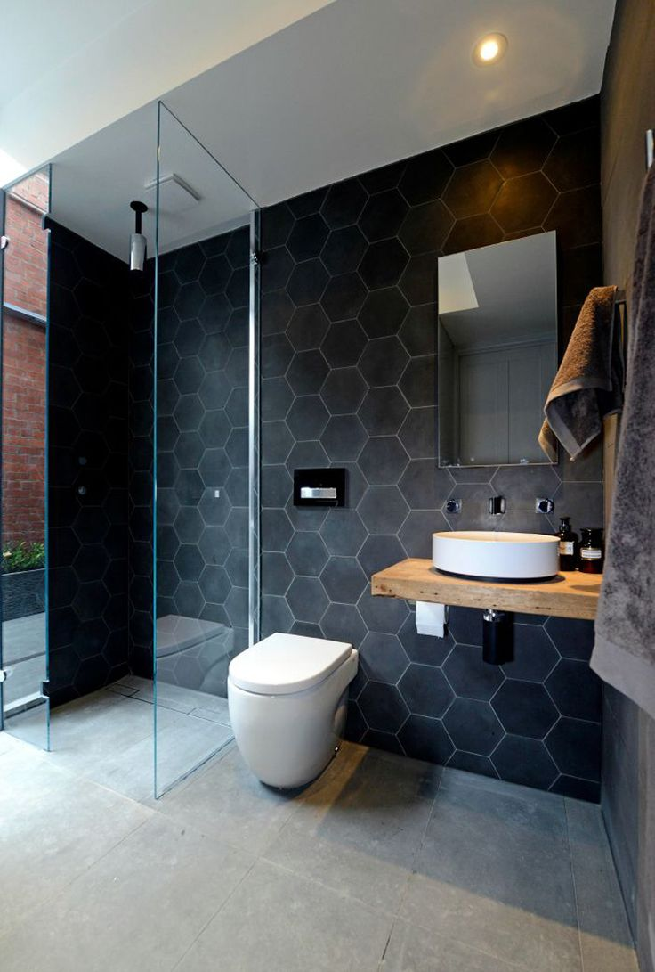 dark grey wall tiles, light grey floor tiles