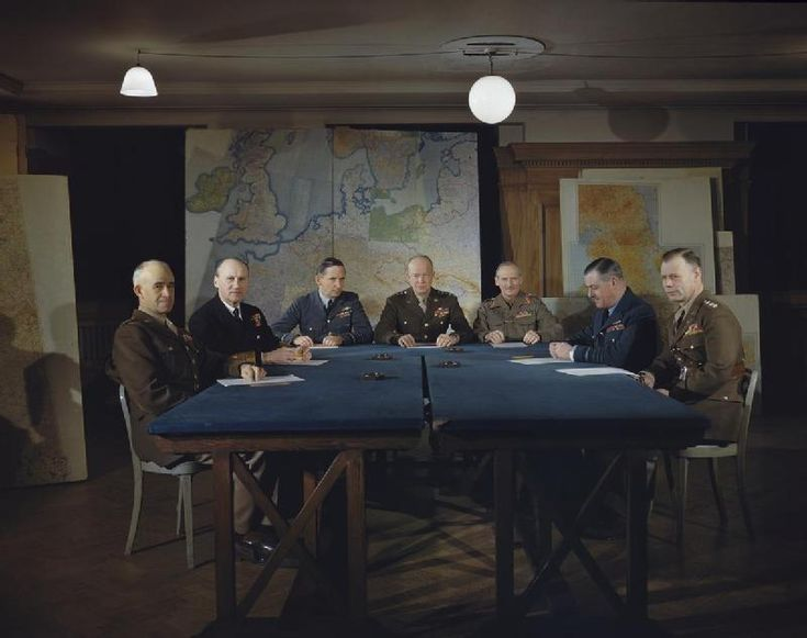Meeting of the Allied Supreme Command in February 1944. Left to right: Lieutenant General Omar Bradley, Admiral Sir Bertram Ramsay, Air Chief Marshal Sir Arthur Tedder, General Dwight Eisenhower, General Sir Bernard Montgomery, Air Chief Marshal Sir Trafford Leigh-Mallory and Lieutenant General Bedell Smith.