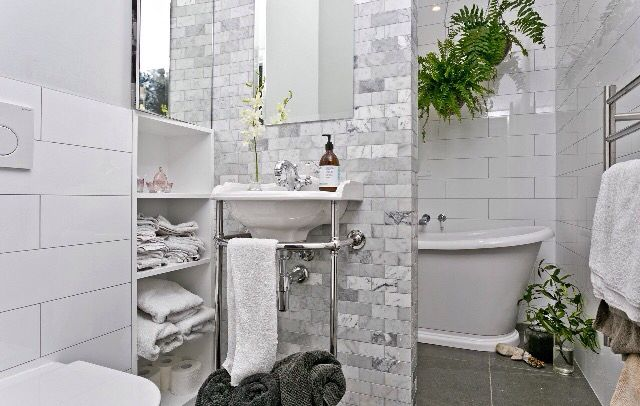 Loved doing this bathroom. Bathroom tiles. Marble brickwork tiles for the nib wall integrate well with the large slate grey floor tiles at 600mm x 600mm, with all wall tiling in brickwork design using rectangular white gloss tiles. All from Heritage Tiles.