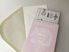 Personalised wedding invitations including pocketfold invitations, passport invitations, boarding card invitations, tickets and embellishments
