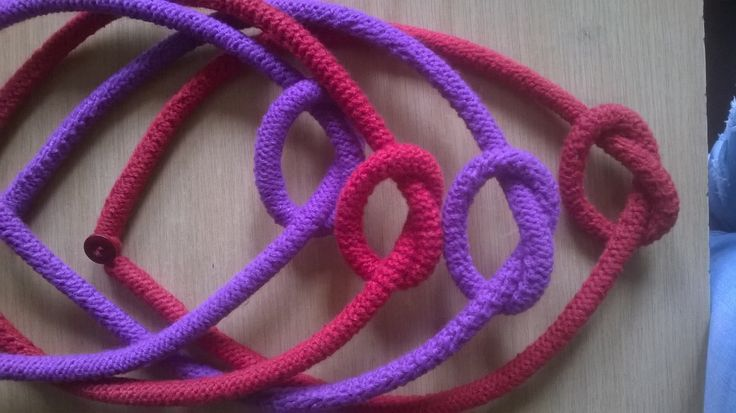 Twined Words loop knot knitted bangle available in different colour range of blues & reds.