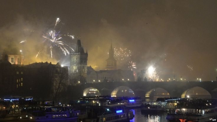 Fireworks explode above the Charles Bridge during the New Year celebrations in Prague (one hour ahead of Greenwich)