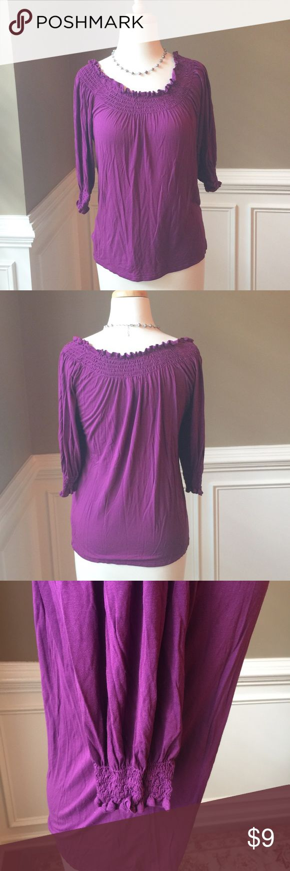 """Karen Kane purple top Pretty purple top from Karen Kane. Smocked and neckline and sleeve cuffs. Can be worn off shoulder. No rips, stains, odors. Just gentle wear. Smoke and pet free home. Approx 15"""" across bust, 22.5"""" long, 12"""" sleeves. Rayon/spandex blend. Dry clean. Bundle/make offer! Karen Kane Tops Tees - Long Sleeve"""
