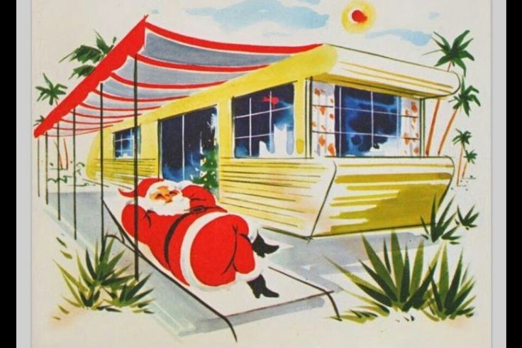 Santa chillin' 'neath the awning of his vintage travel trailer