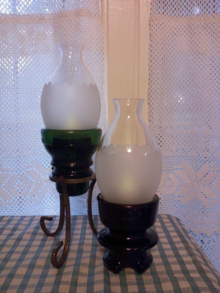 I was wondering what to do with these glass chimneys....so I added them to a couple more insulators and some electric votives and.....presto! Cute new lamps!