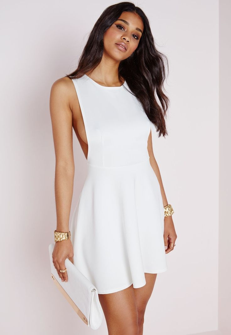 Look seriously seductive this season in this white skater dress and ensure all eyes on you. With fanciful deep plunging v detail to reverse and chic low arm holes this dress will give you a standout silhouette. Team with bold lace up heels ...