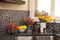 Bringing flowers into your home will brighten up a room — and your mood! The kitchen is where we spend the majority of our time and the most important thing about flowers is to enjoy them every day. Besides, it's the most convenient room to add water.