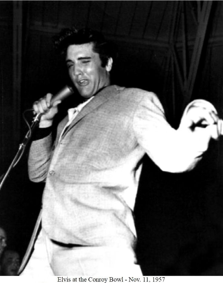"""Elvis Presley performing his last concert of the 1950's at the Conroy Bowl at Schofield Barracks in Honolulu, HI on Monday, November 11, 1957, Armistice Day   """"The loose-jointed idol, dressed in a pearl gray suit and black shirt with his guitar in hand, shimmied and clowned his way through his top hit tunes."""" See more here: http://scottymoore.net/conroybowl.html"""
