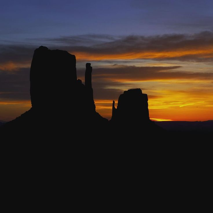 The mittens are two distinctive geological features found within the Monument Valley Navajo Tribal Park in Arizona.  The mesas and buttes surrounded by desert in this area are the epitome of the American Western landscape. This is a view at sunrise just a few minutes from the visitor center. // Photo by @andywcoleman by natgeotravel