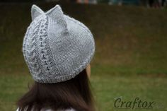 Knit cat ear hat. Back right view. Knit cat ear hat. Free pattern with chart. Cute and unusual cat hat with ears. Your child will definitely like it. The hat is knitted very easy, and will not take much of your time. #knit #cat #ear #hat #free #pattern #chart #easy