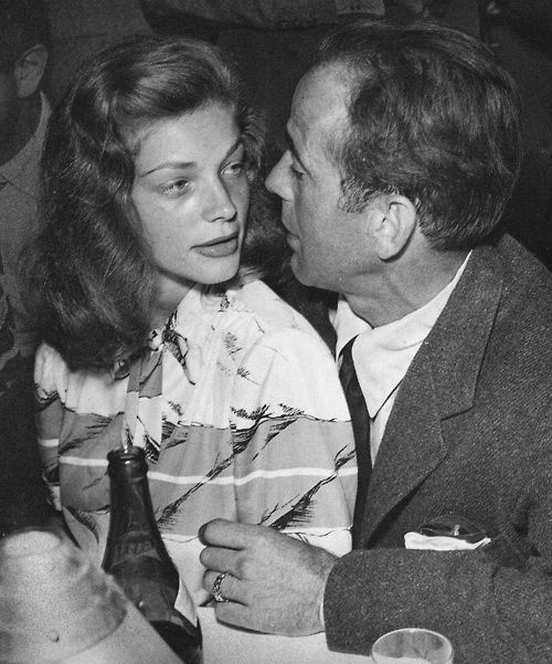 Very early in their relationship --  she was such a child, but somehow strong enough to deal with all the baggage he brought along .....  Lauren Bacall and Humphrey Bogart
