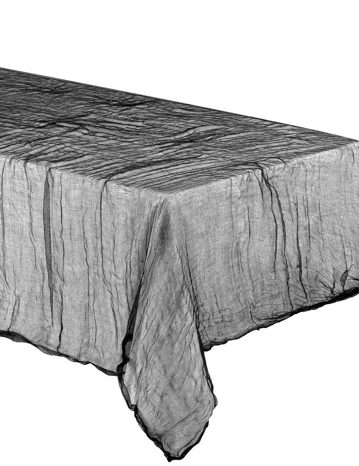 Toalha Halloween lençol furado: Esta toalha é de tecido transparente de cor cinzenta escura.Ela mede a volta de 1.5 x 2.1 metros.Esta toalha será perfeita para realizar um ambiente de terror para a grande noite...