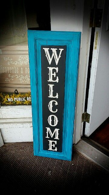 Welcome sign on an old cabinet door with vinyl lettering $35.00