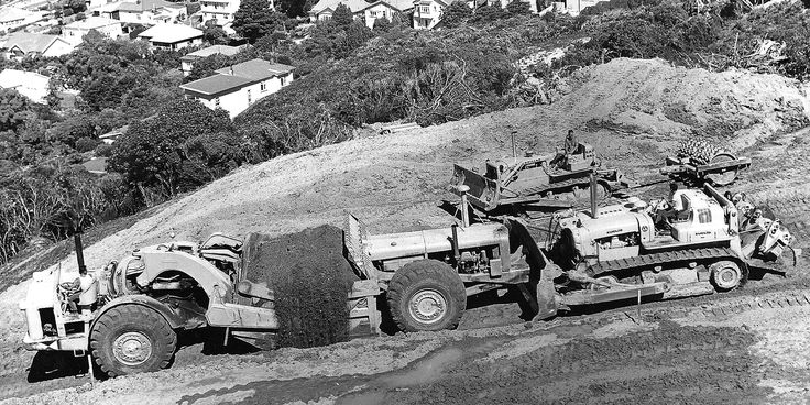 Seen working in Island Bay, Wellington in the early 1960s, this TS-24 belonged to Feast & McJorrow and is getting a push from that company's TC-12 dozer. Note the straight exhaust pipe on the rear engine of the scraper with no muffler - standard supply ex-factory on all pre-1965 Euclid TS-24s
