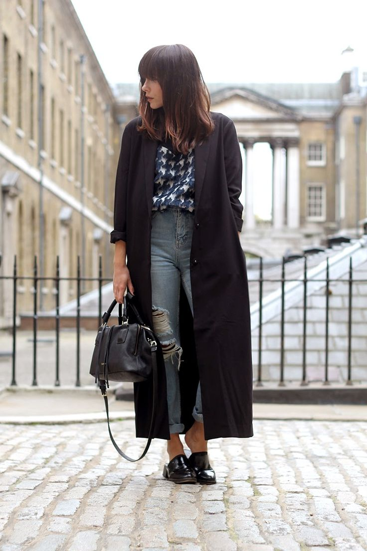 Fashion blogger Megan Ellaby looks great showing off her Calvin Klein handbag at Somerset House, she's paired it with ripped boyfriend jeans and a long line jacket for laid back chic.