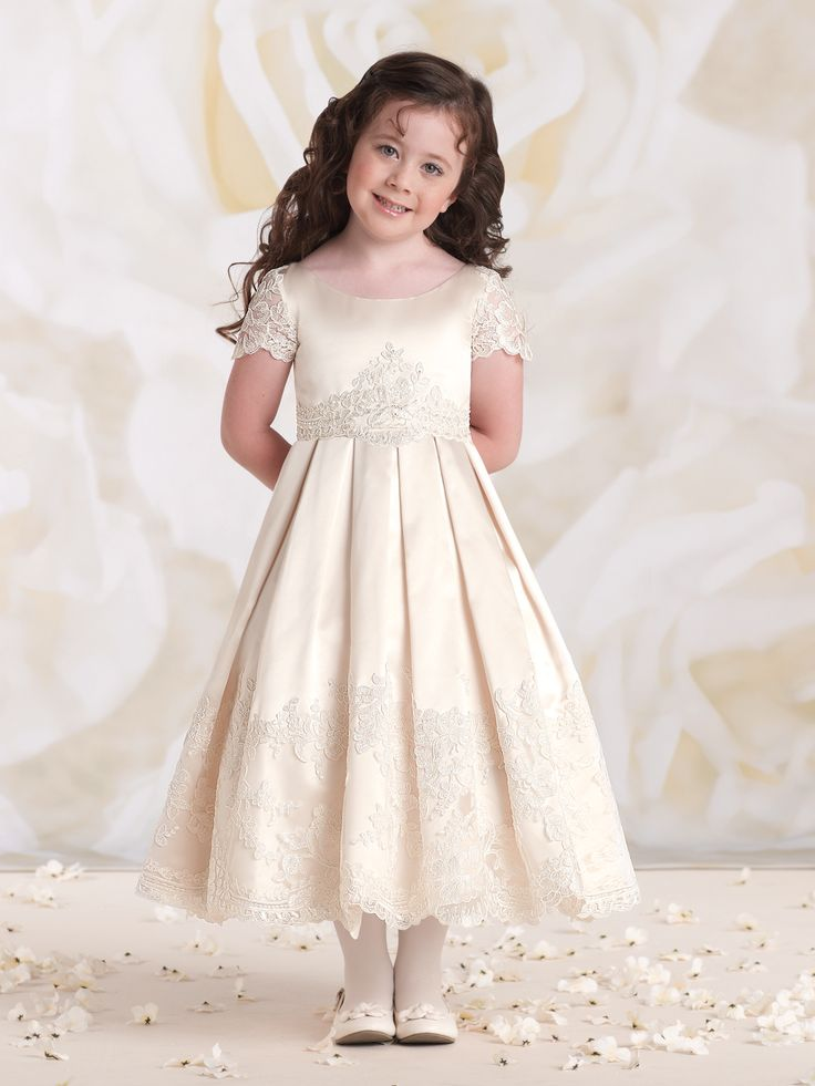 Calabrese Girl   Style No. › 113361   Satin and lace tea-length A-line dress with illusion lace short sleeves, scoop neckline, re-embroidered lace motif at waistline, full circle box pleated skirt with matching wide re-embroidered lace appliqué hemline. NEW for Spring 2015: Gardenia/Ivory. Sizes: 4 – 14
