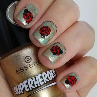 Leonie's Nailart: Stamped Ladybugs over golden flowers