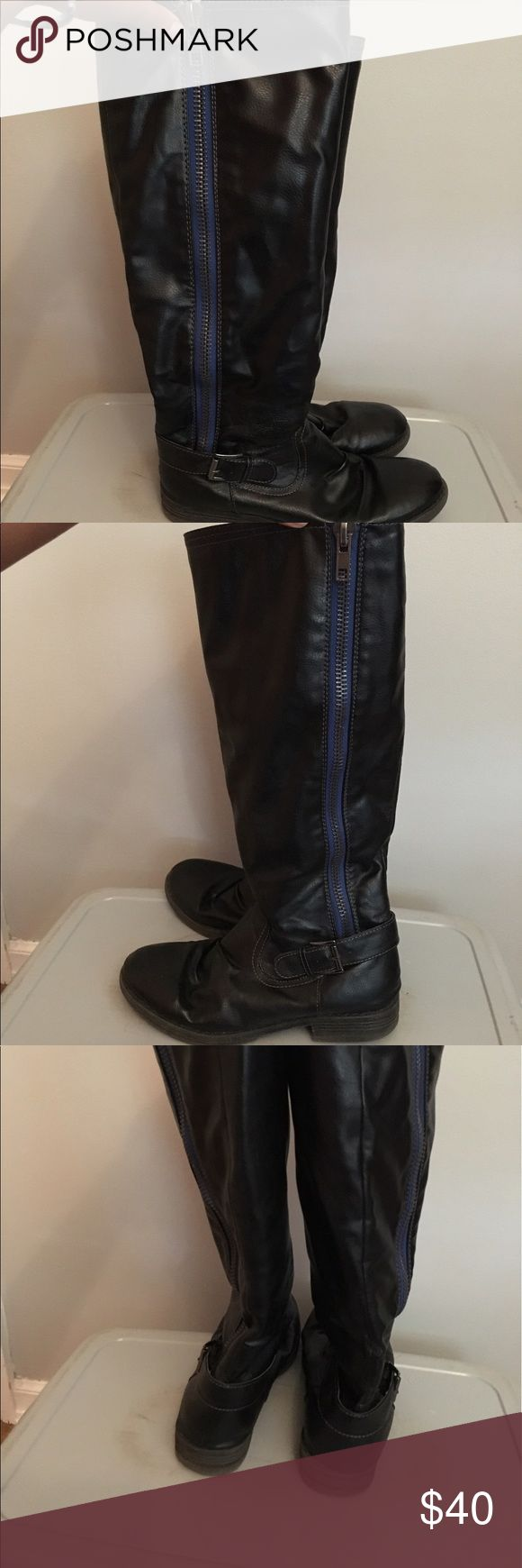 Steve Madden Black Boots steve madden tall boots. good condition. has zipper on the side with a blue design. small little heel Steve Madden Shoes Heeled Boots