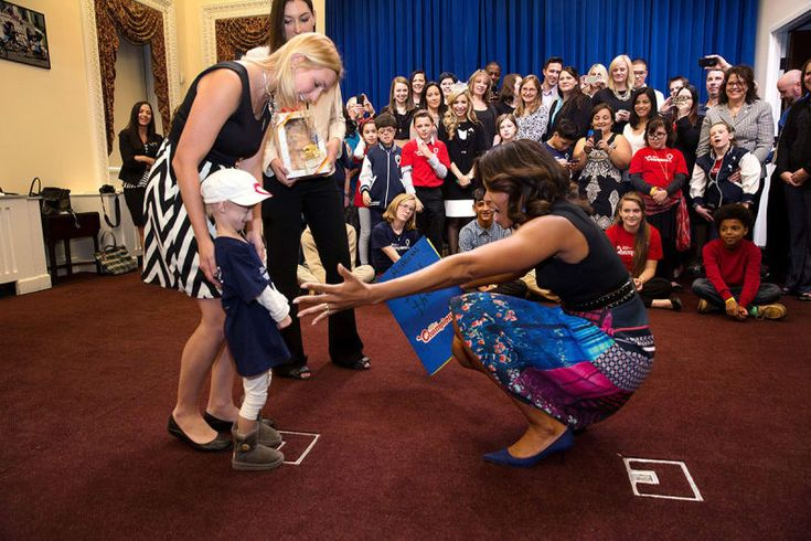 Obama reaches out to a child from Children's Miracle Network Hospitals during their visit to the Eisenhower Executive Office Building of the White House on Nov. 10, 2014.