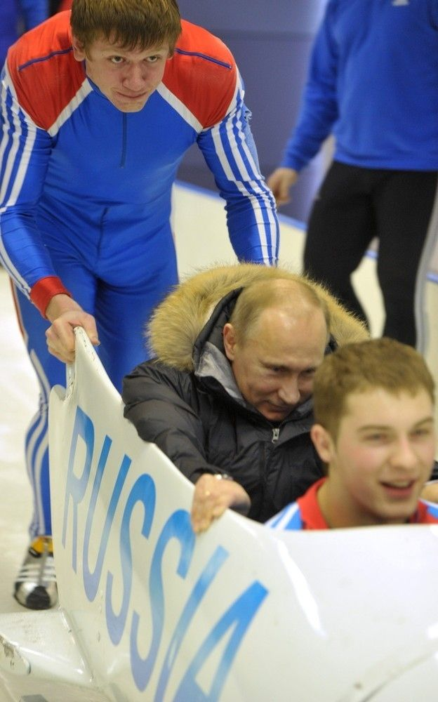 He has fun in sleds. | 32 Pictures That Prove Vladimir Putin Is Only Human