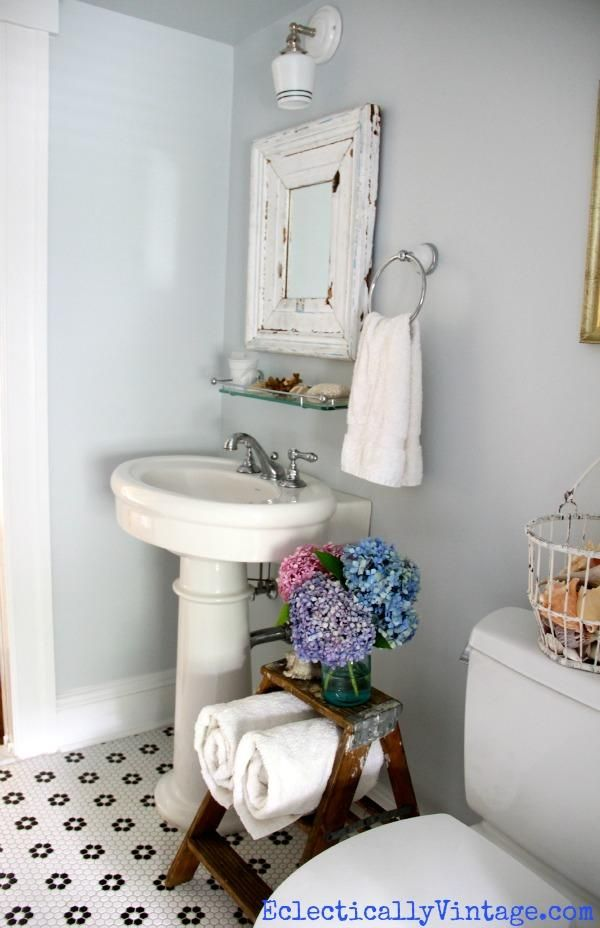Bathroom storage ideas love this old ladder pedestal for Old tile bathroom ideas