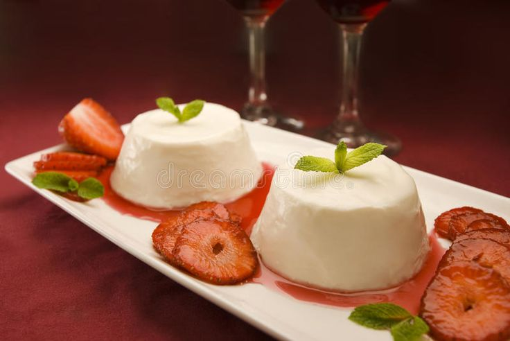 Photo about Italian panna cotta dessert garnished with fresh mint, strawberries and syrup. Image of glasses, culinary, italy - 19305111