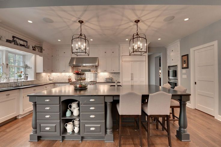 Traditional Kitchen with Slate counters, Carrara White 3x6 Polished, Undermount Sink, Breakfast bar, Kitchen island, L-shaped
