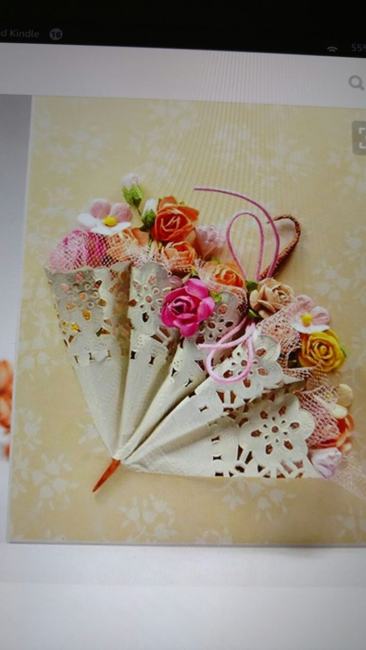 Paper dolies folded  to form an umbrella. . .Great for bridal shower decor or corsage for bride