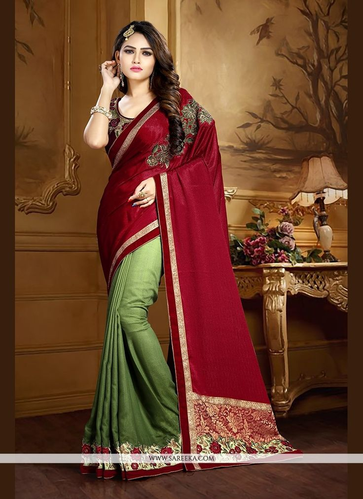 Vogue and pattern will be on the peak of your magnificence as soon as you attire this green faux crepe traditional  saree. The ethnic embroidered and patch border work to your clothing adds a sign of ...