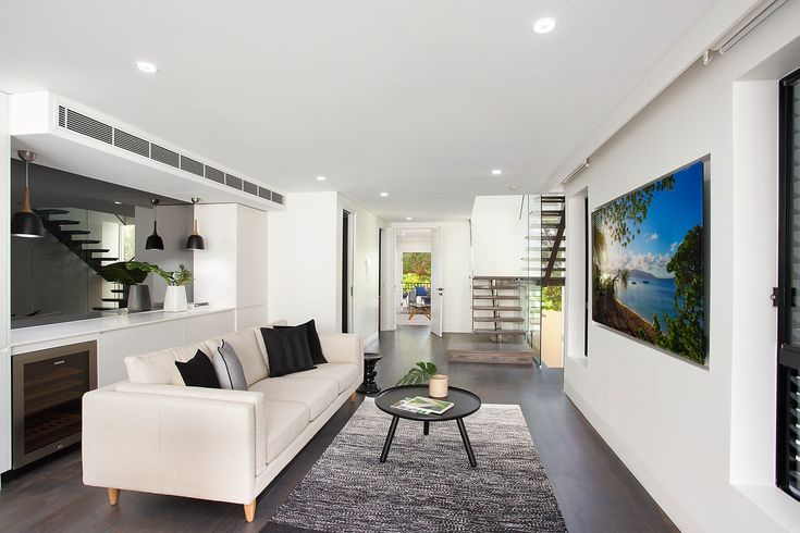 Easy flowing open-plan living, living area, built in cabinetry, Sony TV, coffee table, lounge, mirrors, ducted air con, Pilcher Residential