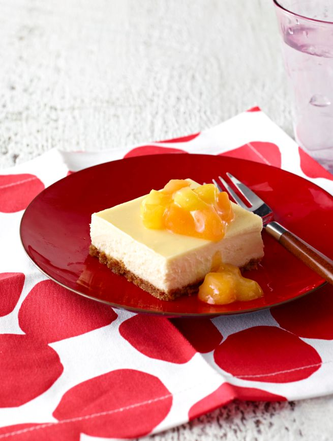 Pineapple-Mango Cheesecake Recipe - a fresh cheesecake idea that serves 24, great for your next gathering!