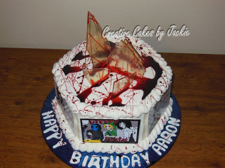 The Aaron  Menu Choice: Ooh La La French   The cake was surrounded in gumpaste pics of the Creepy Pasta comic and featured shards of edible sugar glass and blood.  For a quote on this cake please text 903-815-7633 or email at creativecakesbyj@gmail.com