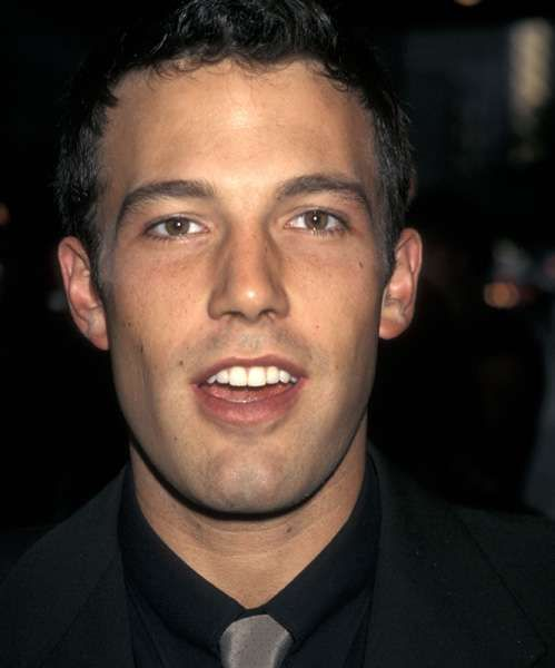 Young Ben Affleck in a Black Suit with Gray Tie