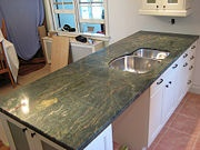 A tutorial for sealing granite countertops. Cursing my seller's ex-wife for picking granite countertops during the remodel.