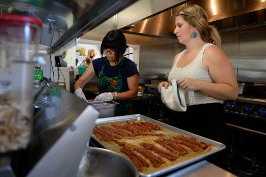 LITTLETON, CO - JUNE 15: Chef Laura Grannan, right, supervises volunteer Kris Tominaga in the kitchen at GraceFull Community Cafe on June 15, 2016, in Littleton, Colorado. GraceFull Community Cafe is a hybrid for-profit cafe and non-profit foundation that provides meals to those in need at no cost, while also offering food and beverages to patrons who are able to pay the full cost for their meals. (Photo by Anya Semenoff/The Denver Post)