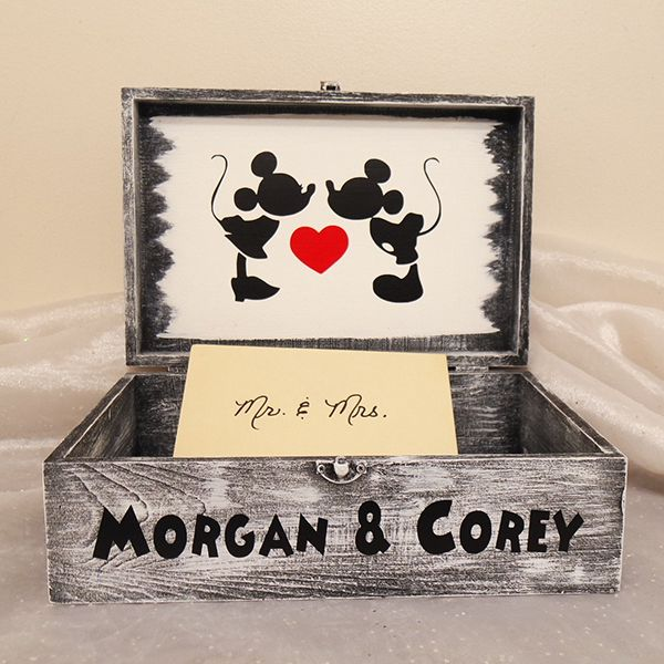 A shabby-chic box with an antique, weathered look is a popular choice, but this Minnie and Mickey variation stands out from the pack. We love the idea of personalizing your card box with illustrations or decals.