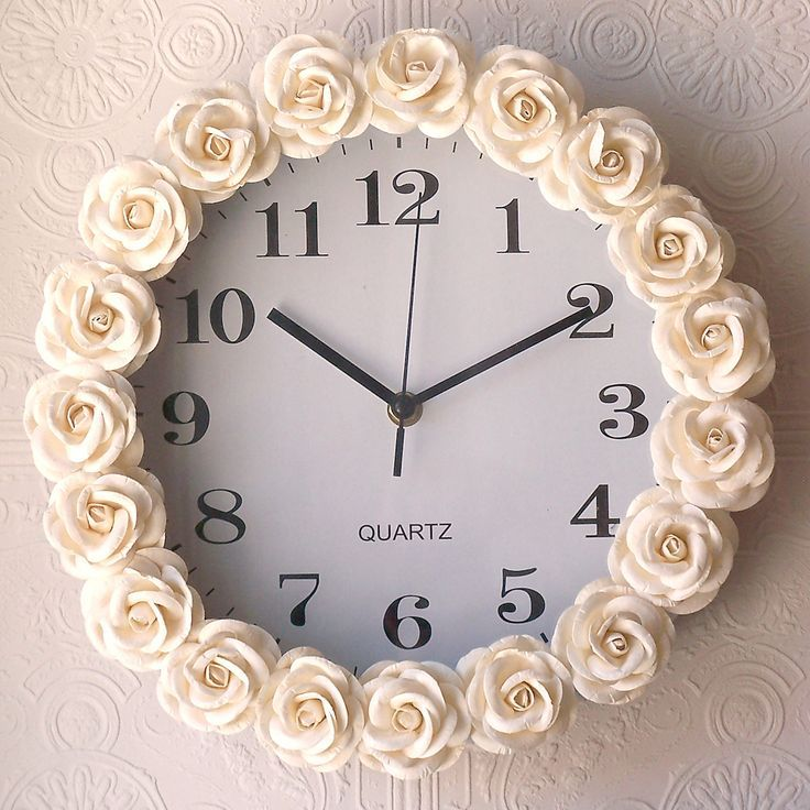 Buy a cheap clock, hot glue fabric rosettes around it... Don't love the flowers, but it's a great tip to use whatever one likes!