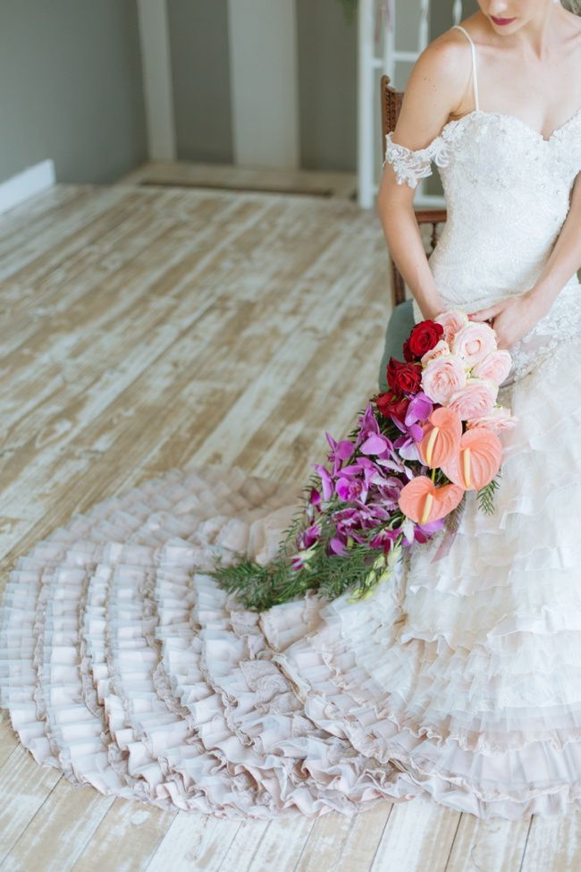 Orchid Wedding Bouquet and romantic, ruffled, off-white wedding dress: http://www.confettidaydreams.com/orchid-wedding/