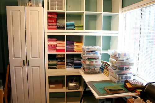 How to fold fabric for stacking fabric storage ideas for Studio apartment storage ideas