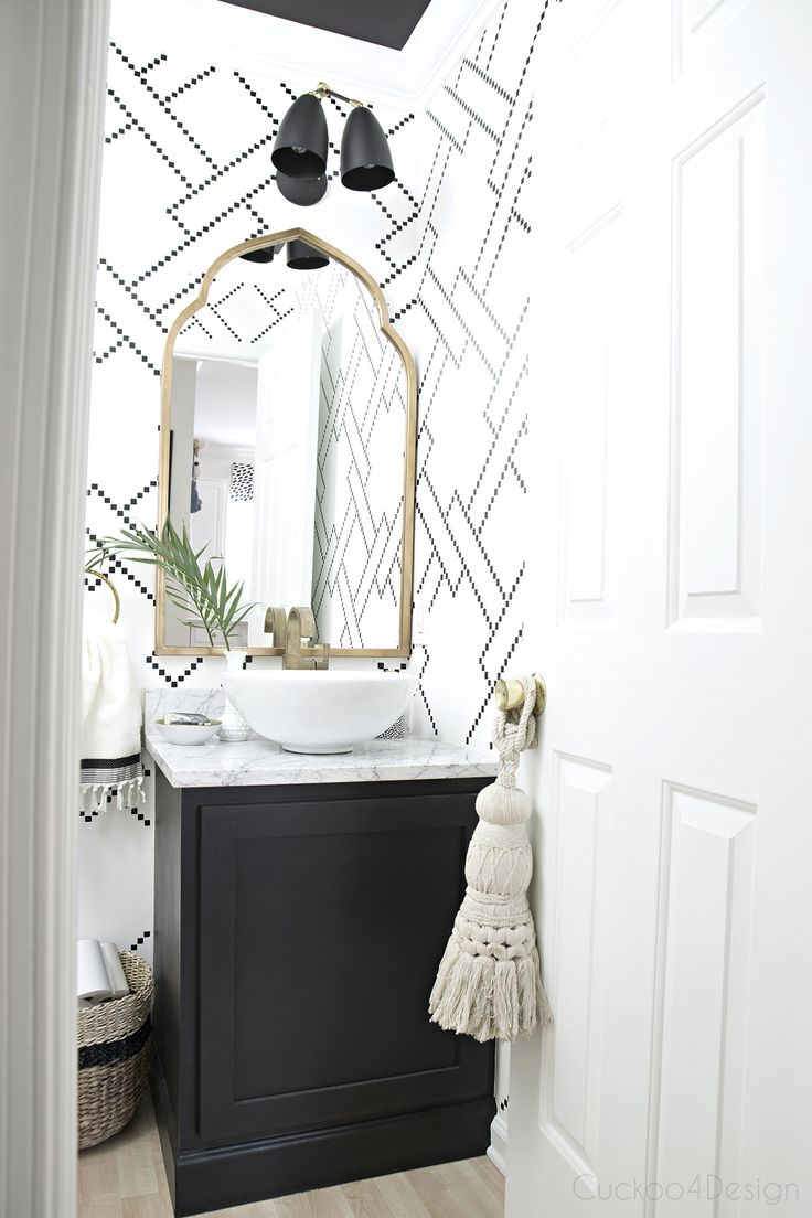 Black and white sharpie stenciled bathroom with gold accents, marble countertop and handmade light fixture