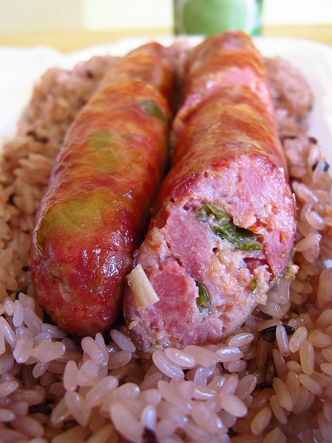 Hmong pork sausage and purple sticky rice in Fresno, California... by A Culinary (Photo) Journal, via Flickr