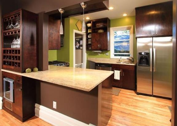 Birch cabinets stained dark walnut with light wood floors ...